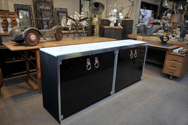 Modernist and Design Credenza in of two cabinets with two smoked glass doors opening by 2 leather brown handles .Perfect condition new Carrara marble tops (W 100 cm each ). Sides and back covered with black felt in very good condition. Both cabinets
