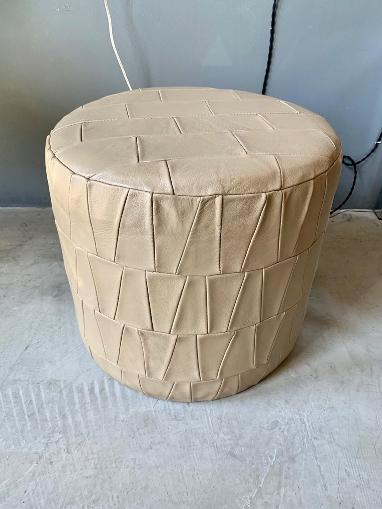 Patchwork leather ottoman by De Sede in crème patchwork leather. Very good condition. Great accent piece.