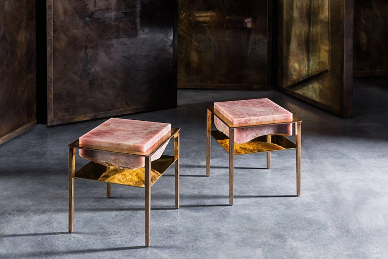 Each of these unique tables by acclaimed artist and master-craftsman, Gianluca Pacchioni, is handcrafted at the sculptor's studio in Milan. Slabs of individually sourced and hand-hewn pink onyx are suspended mid-air by uncannily thin legs.   A