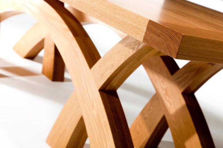 Crescent dining table in solid oak or walnut with a robustly constructed sculptural table.