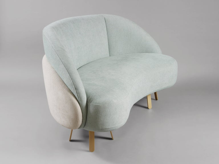The 'Crescent Loveseat' by French-Lebanese designer Charles Kalpakian is a contemporary reinterpretation of several major classics from the 50's. The comfortable crescent shaped design offers soft, pure yet flexible lines enhanced by the contrast of