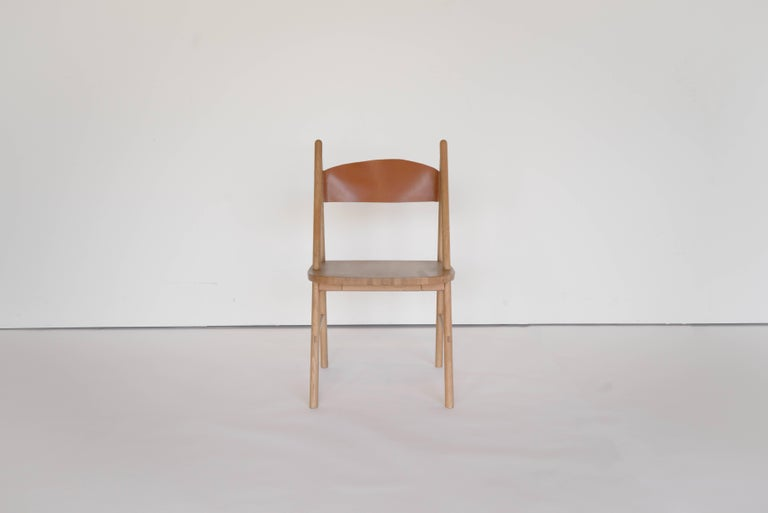 Sun at Six is a Brooklyn design studio. We work with traditional Chinese joinery masters to handcraft our pieces using traditional joinery. Handcrafted using traditional joinery. A concave leather back makes this dining chair a good choice for