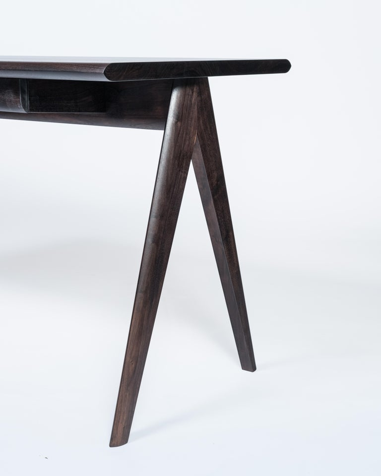The Crest desk is the newest addition to the Crest collection. The rolling edges make for comfortable writing or computer use. A single drawer with an incorporated pencil tray stores the essentials yet keeps the desk looking clean and simple. It's