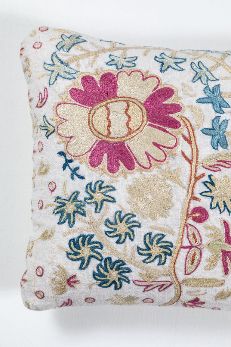 Silk floss floral embroidery on hand woven linen. European. Backing is same line without embroidery. Invisible zipper closure and feather and down fill.