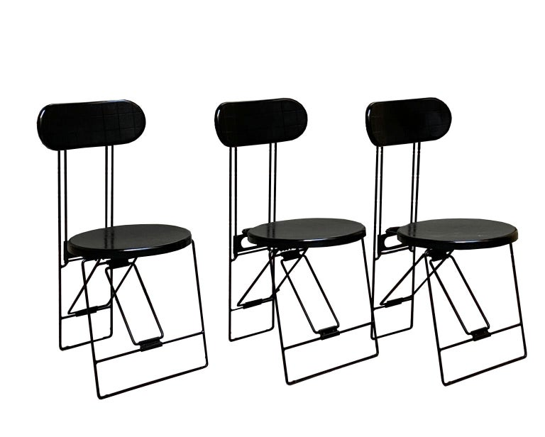The chair was designed by Andries van Onck and Kazuma Yamaguchi for Magis, Italy. Memphis style folding chairs from 1983. The seating and the back is made of heavy quality black pvc. The black-coated frame is made of massive wire steel.