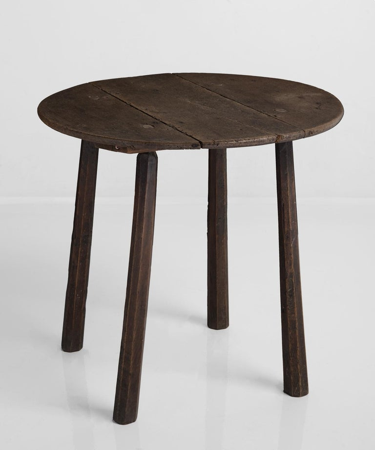 Cricket table, England, 19th century.  Minimal, primitive form with stick legs and rich patina.