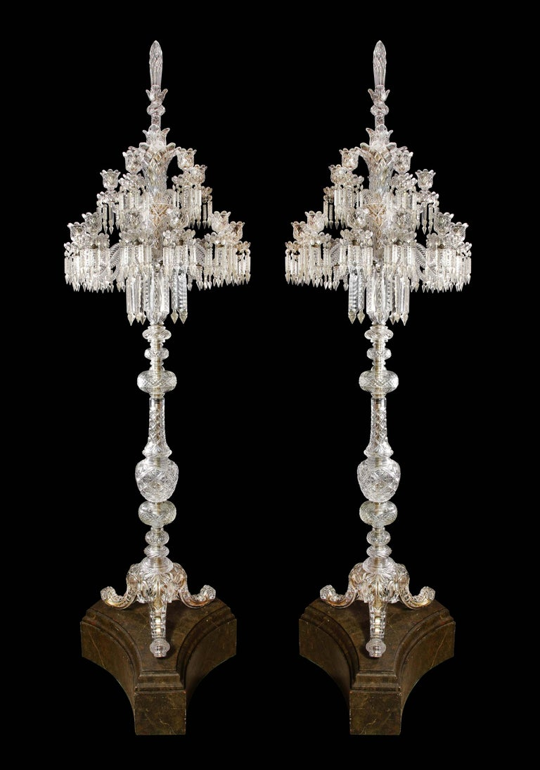 Cristalleries De Baccarat, a large pair of French cut-crystal eighteen light torcheres, early 20th century.  These are extremely rare and unique standing floor chandeliers by Baccarat, Paris.  Each central stem issuing eighteen out-scrolled