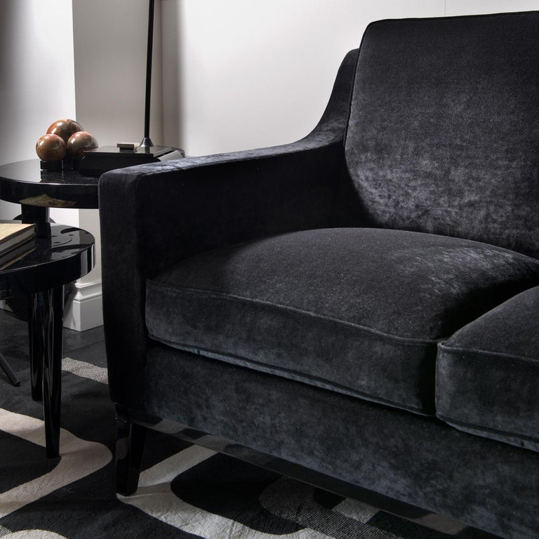 An ideal addition to a small living room, or as an extra seat in a study, walk-in closet, or bedroom, this loveseat is part of the Cristine collection, also available as armchair and pouf. Designed by creative director Domenico Mula, this piece