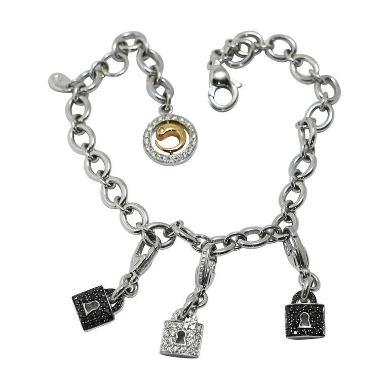 Crivelli Charm Bracelet in 18 Karat White Gold and White and Black Diamonds For Sale