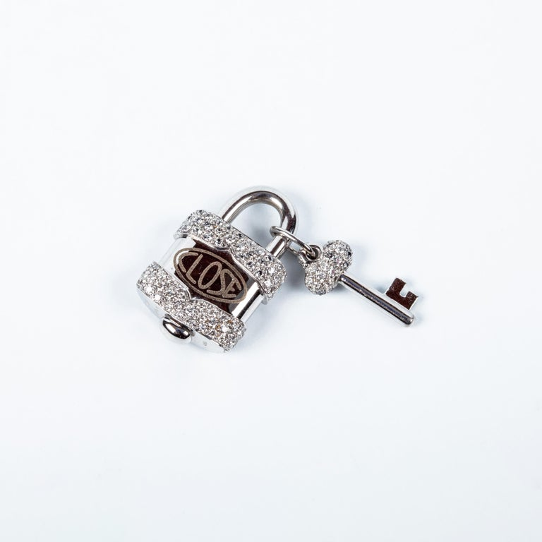 Charm Link Lock Pendant or Closure 18 Karat White Gold and Diamonds Open Close was founded in Valenza Italy in the 70's, when Bruno Crivelli decided to transcend his vast experience and craftsmanship to form what is known today as: Crivelli
