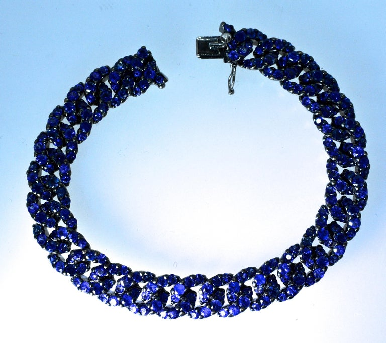 Crivelli bracelet pave set with 232 fine bright natural blue sapphires, all well matched and well cut, weighing exactly 16.26 cts., (marked with the weight on the verso), this link bracelet is 7.25 inches long and in excellent condition.