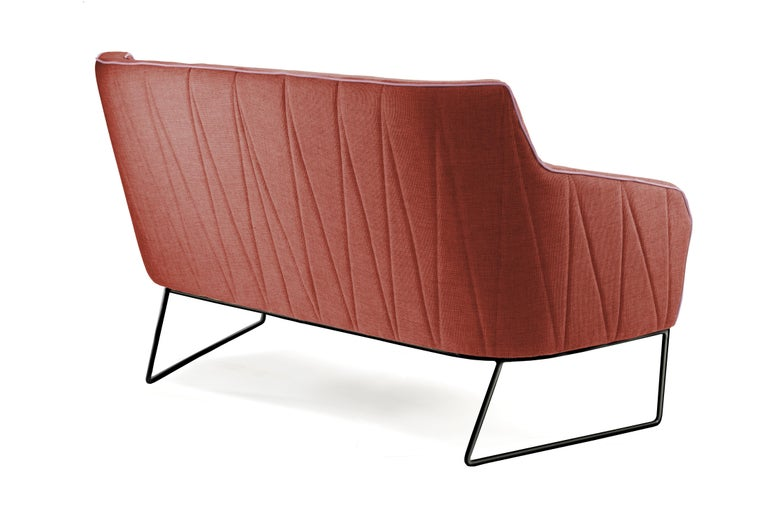 Delicate seaming in diagonal shapes throughout Croix upholstered back contrast with the smooth seating. Stylish and elegant, this settee is extremely comfortable in its' perfect finishing's. With each fabric and metal base lacquer combination it