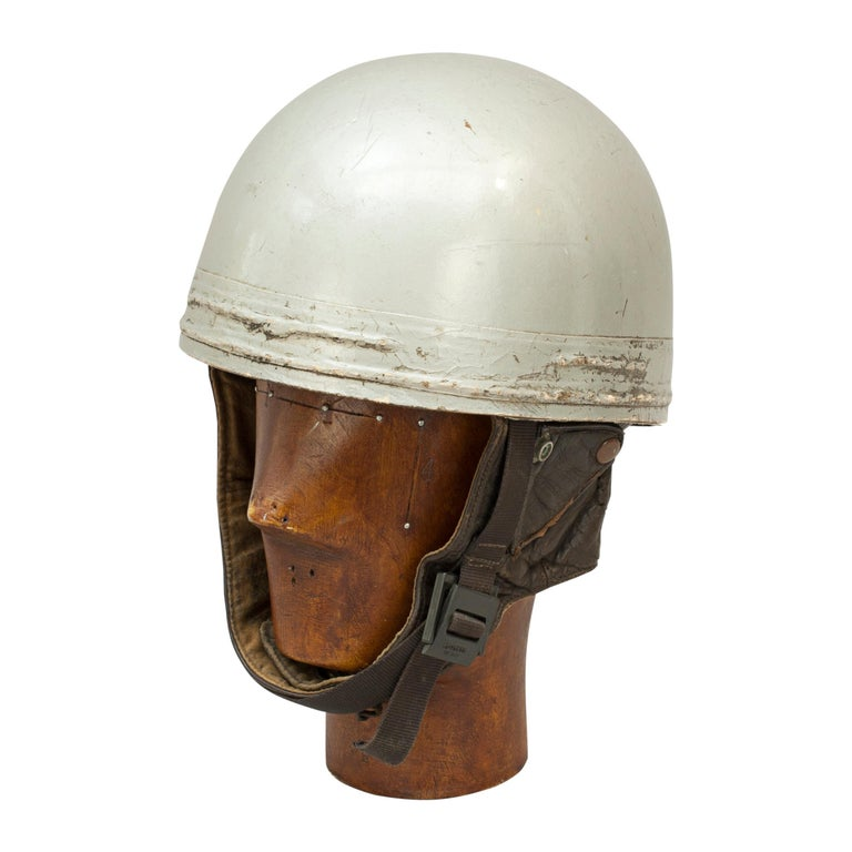 A.C.U approved Cromwell racing motorcycle crash helmet. A silver painted motorcycle, pudding basin shape helmet made in England by Cromwell. This helmet has a cork interior, fitted with a fabric headband and straps keeping a space between the head