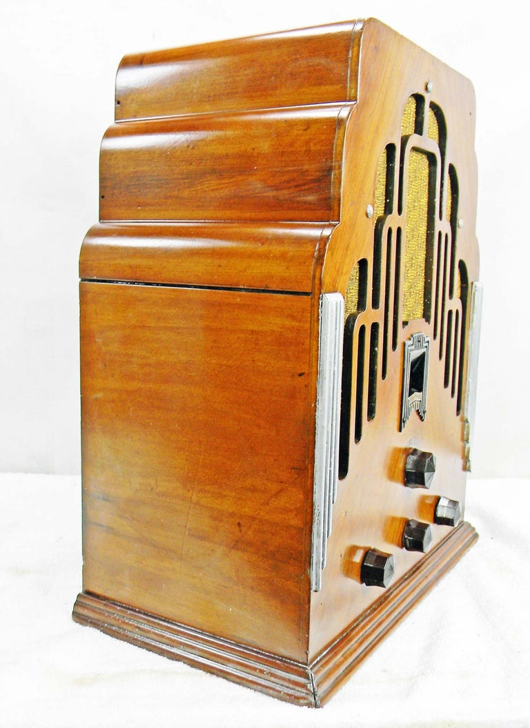 "Art Deco Crosley radio from the earlier 1930s. The radio is highly decorative with a ""skyscraper"" shape, a chevron book-match face, silver-painted sides, and a highly detailed frame around the dial. You will be able to play all of your personal"