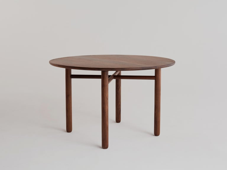 Cross bar table by Campagna, shown in walnut.