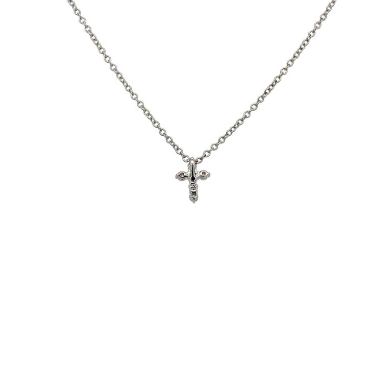 Cross Diamond Pendant Necklace made with real/natural brilliant cut  diamonds. Diamond Weight: 0.12 carats. Mounted on 18 karat white gold.