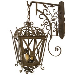 Cross and Rose Forged Iron Exterior Lantern on Bracket