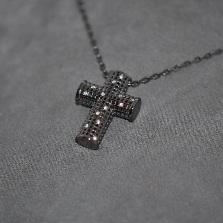 Discover this Cross White Gold Rhodium Black and White Diamonds Pendant Necklace. White Diamonds 0.6 Carat White Gold 18K Rhodium Black White Gold 18K Rhodium Black Chain