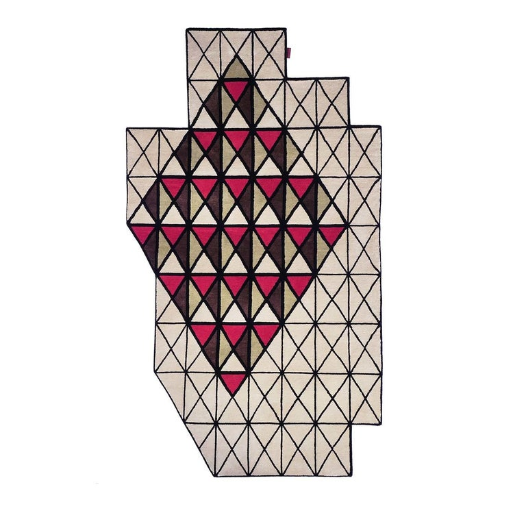 This unique wool and viscose rug is hand knotted into an asymmetrical geometrical pattern and is sure to liven up any floor of a home or office space. The rug's design is divided into alternating rectangular and triangular shapes in beige, light and