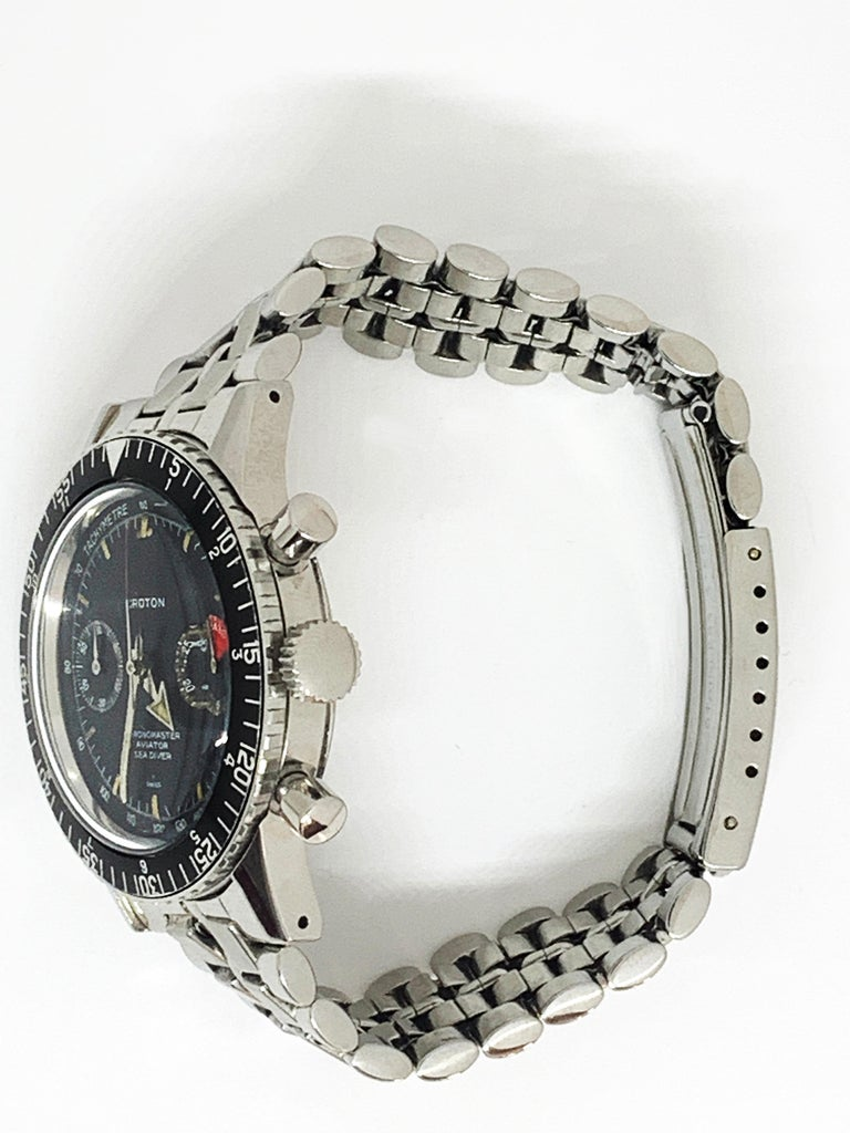 Croton Chronomaster aviator seadiver Around 1960 Steel case Hand-wound mechanical movement Caliber Valjoux 23 Diam: 38mm Steel bracelet signed Nivada 3200 euros