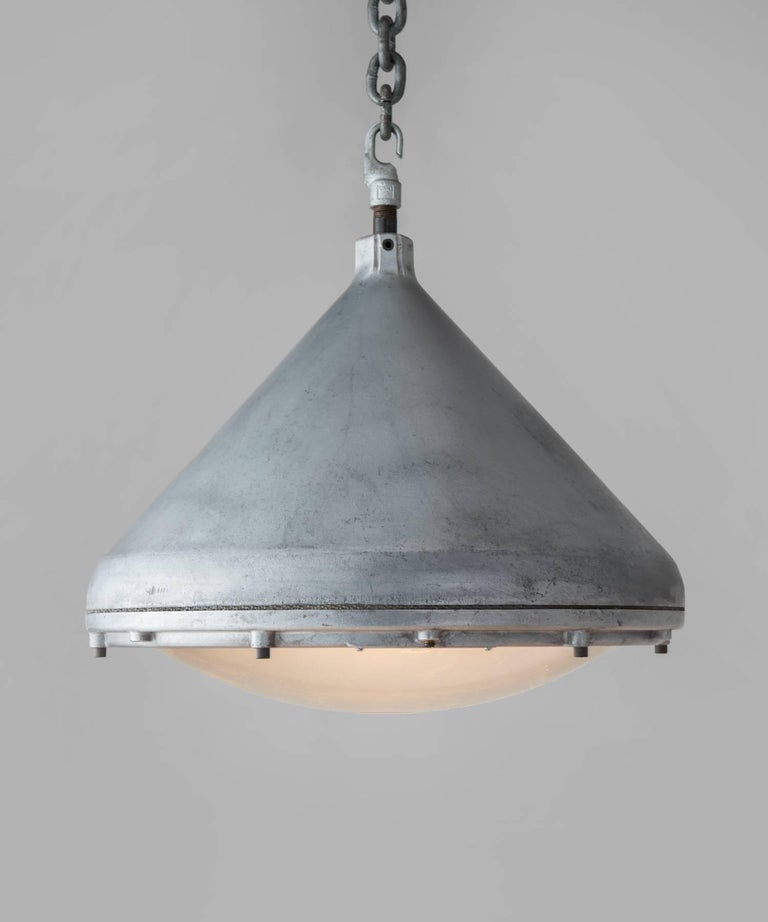 Crouse-Hinds aluminium pendant, America, circa 1950  Generous, industrial form with luminous pyrex lens hinged to aluminum fitter. Includes manufacturer's seal.  17.5