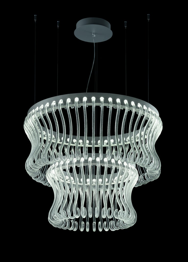 Originally designed in 2017 by Brian Rasmussen, here you are shown the Crown 7337 Suspension Lamp in Crystal Glass and Painted Grey Finish. The pastoral is a full-glass decorative element, characteristic of the Venetian chandelier which has become