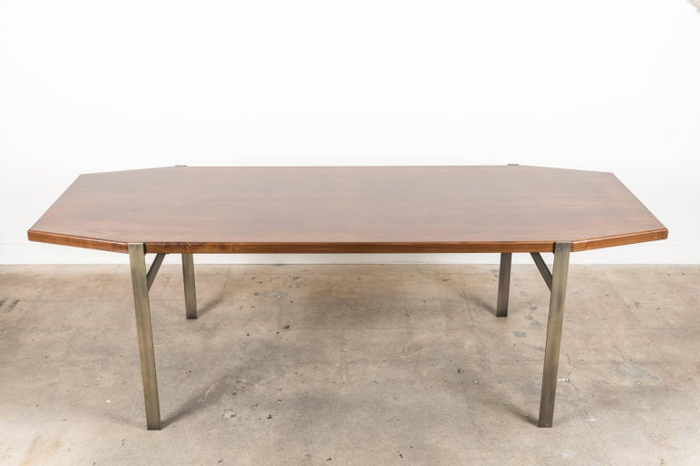 The Cruz Dining Table features a geometric wood top made of American walnut or white oak and modern plated steel legs.  Available to order in various finishes with a 10-12 week lead time.