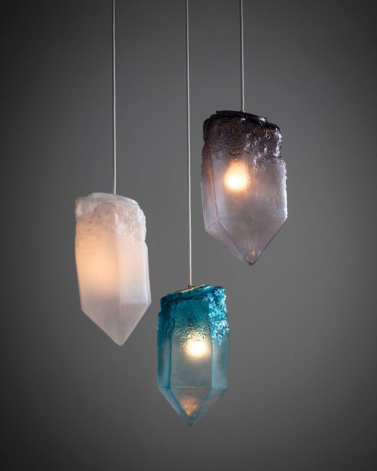 Crystal illuminated sculptural pendant in hand blown glass. Designed and made by Jeff Zimmerman, USA.