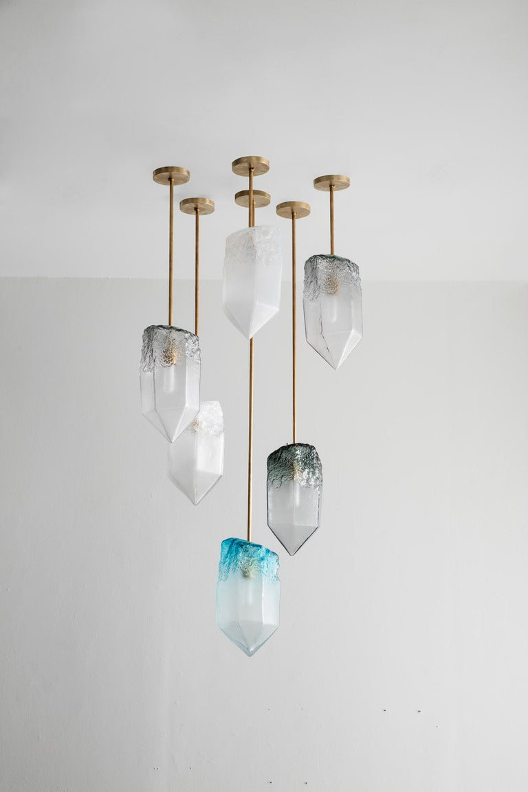 Crystal illuminated sculptural pendant in hand blown glass. Designed and made by Jeff Zimmerman, USA.  Due to the handmade nature of this piece, color, size, and shape may very slighty.