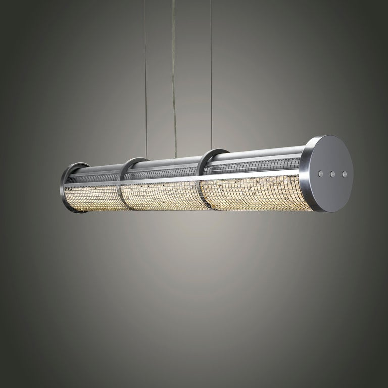 New for 2021, The crystal cage LED linear suspension shines powerful LED luminaries through a stainless steel cage full of chandelier crystal for a sleek linear suspension that shimmers while providing plenty of light.  As the use of LED