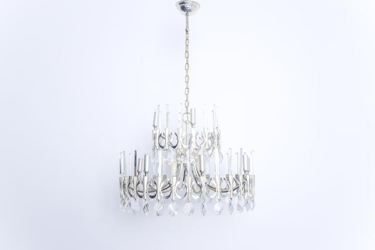 Twelve round chandelier with crystal pendants and fixed crystal rods on two levels. In excellent condition, wiring has been checked and confirmed to be sound, newly cleaned.