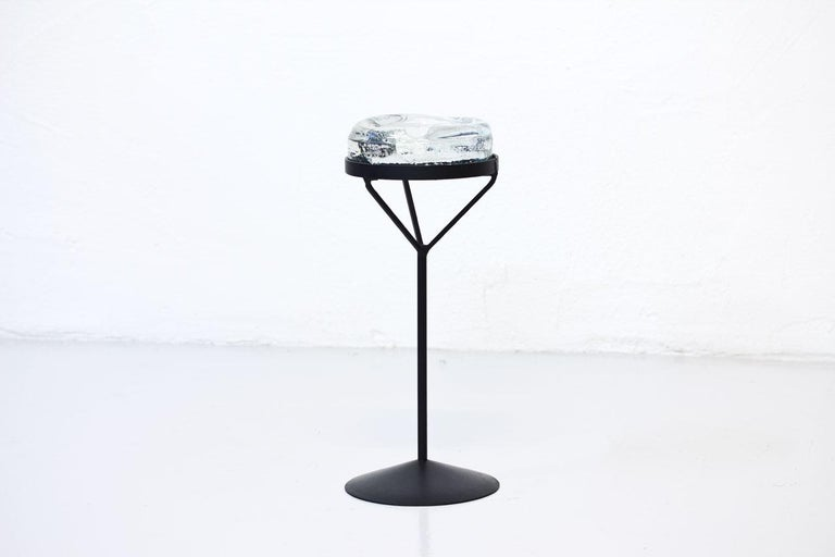 Crystal glass ashtray with iron stand featuring female breast expression.  Designed by Erik Höglund. Manufactured by Boda in Sweden during the 1950s.