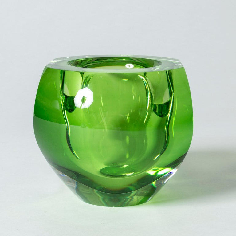 Crystal glass bowl by Mona Morales-Schildt, in heavy quality and a striking, poisonous green color. Dramatic design with a play of light in the thick glass.