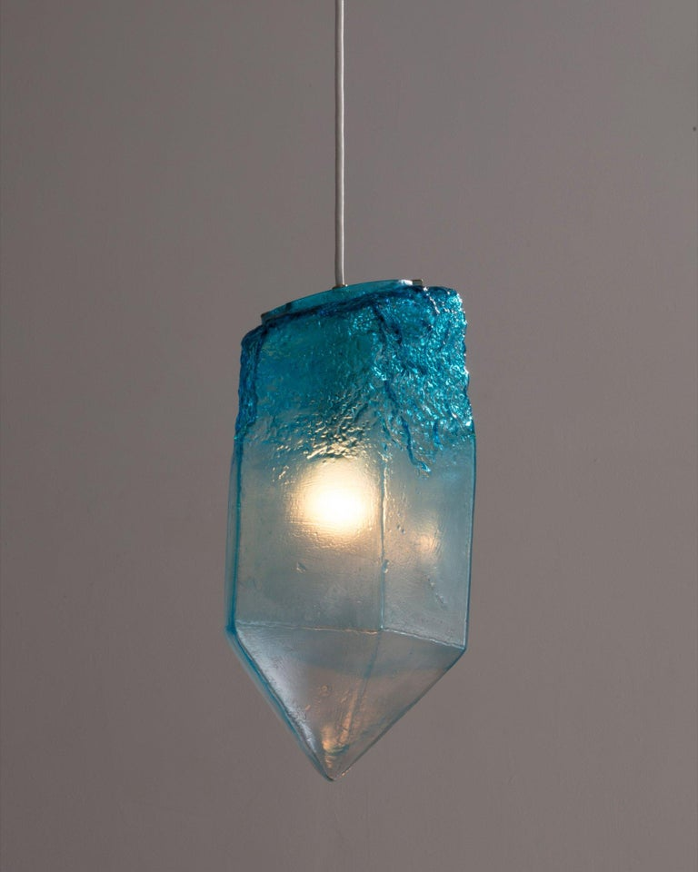 Crystal illuminated sculptural pendant in hand blown turquoise glass. Designed and made by Jeff Zimmerman, USA, 2016.  Limited number available. Please note that each item may differ slightly in color and shape.