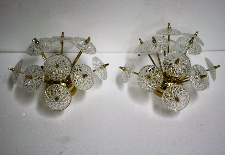 Pair of crystal and brass sputnik wall lights or flush mount fixtures.  The crystal is made by the renowned belgium Val Saint Lambert.  Thanks to the crystal glasses the lamp emits a beautiful light.  The lamp has three E14 light sockets which where
