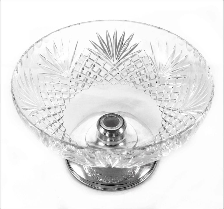 Famous for their cut-glass designs, Hawkes was the premiere glass blower in the late 19th and early 20th century. Of note was there mix of crystal and sterling silver. This particular piece is done in the Pineapple pattern. A series of eight