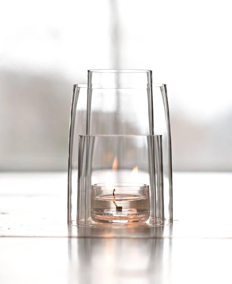 Deborah Ehrlich's crystal tea light hurricane lantern is made up of four nested pieces of handblown, hand-cut Swedish crystal.  Used with a clear tea light candle, the flame moves within the interior, and the three tiers of crystal create endless