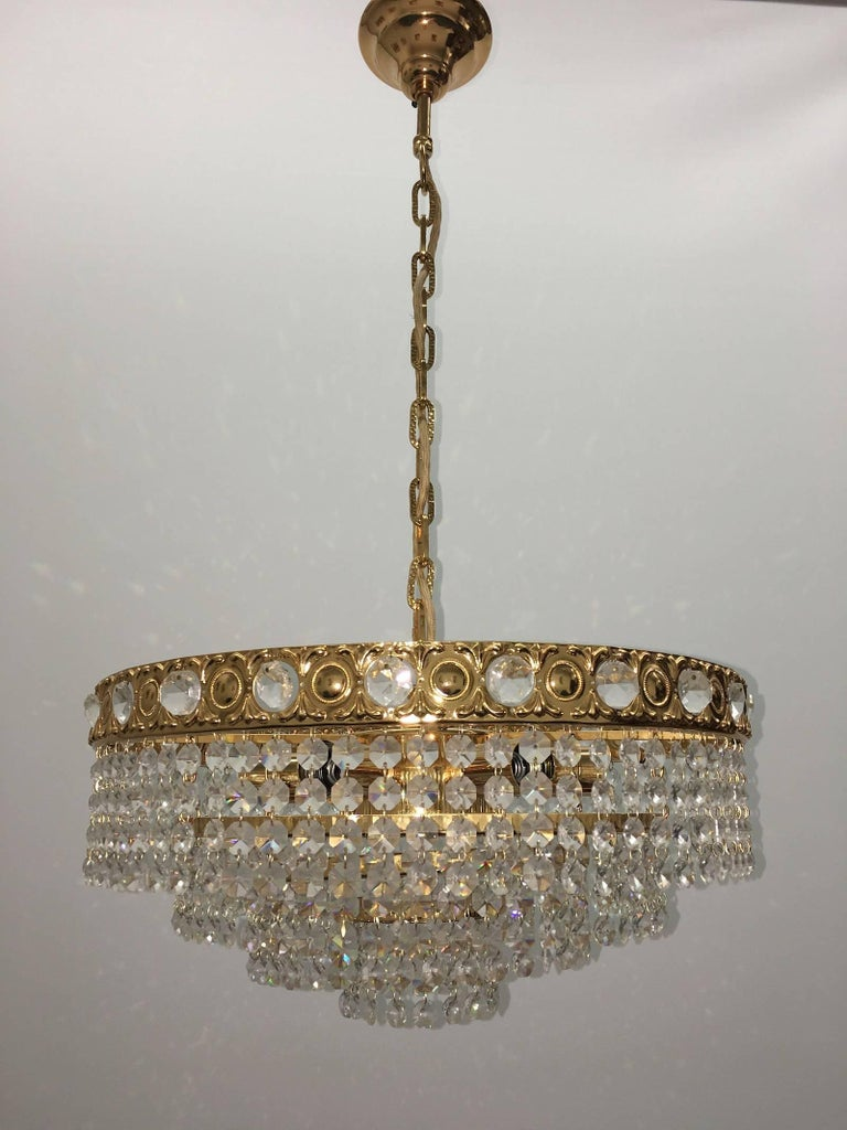 Beautiful, graceful chandelier by Soelken Leuchten of Germany. This Hollywood Regency style fixture will be a wonderful addition in any home.