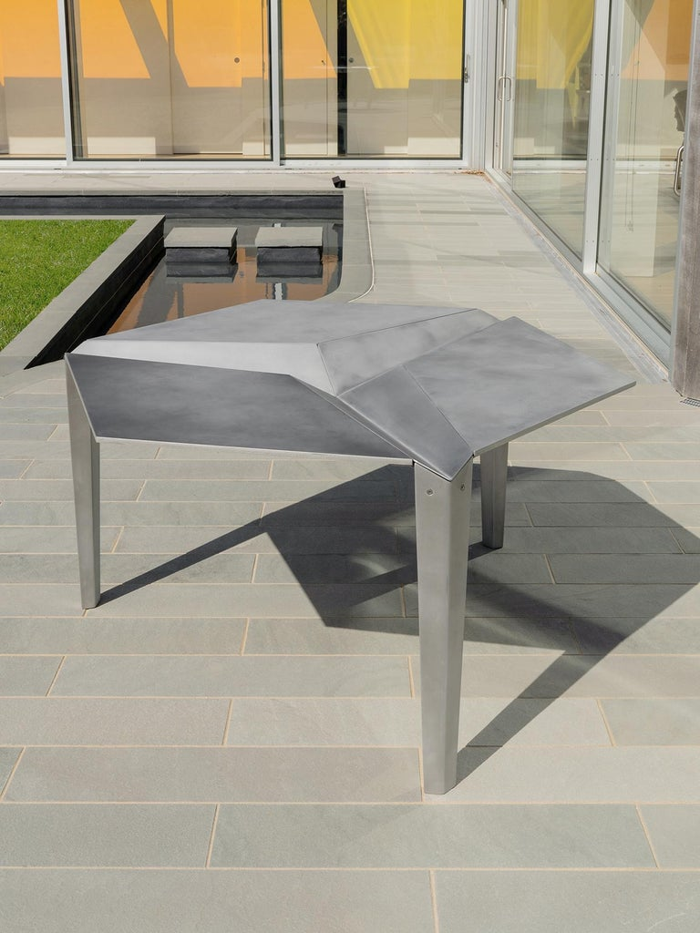 CRYSTALLIZED TABLE  Lightweight Indoor/outdoor dining table for six people, also available in cocktail size. The intent of the dining set is to resemble origami, which suits the manufacturing process of bent metal. NEA Studio worked closely with