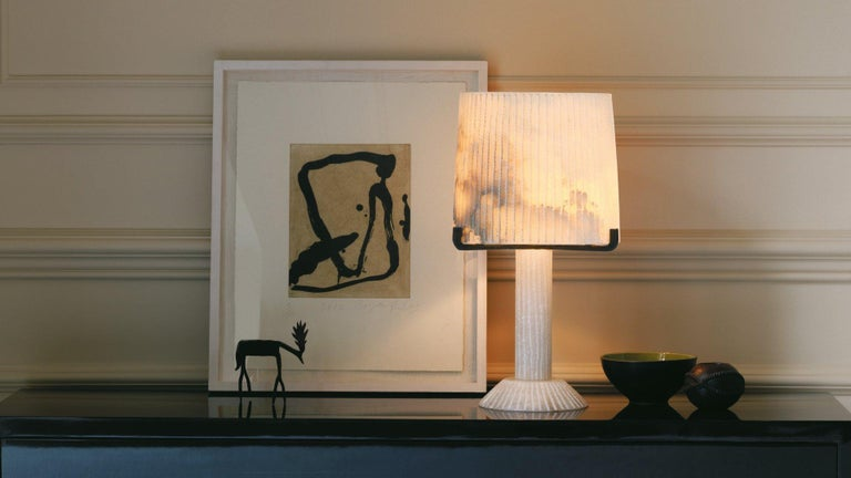 A gorgeous table lamp, made of alabaster reminiscent of an ancient Greek city, the Acropolis is masterful in its execution.  The unique veining of the alabaster means that no two lights are the same. Some are almost white whilst others have grey
