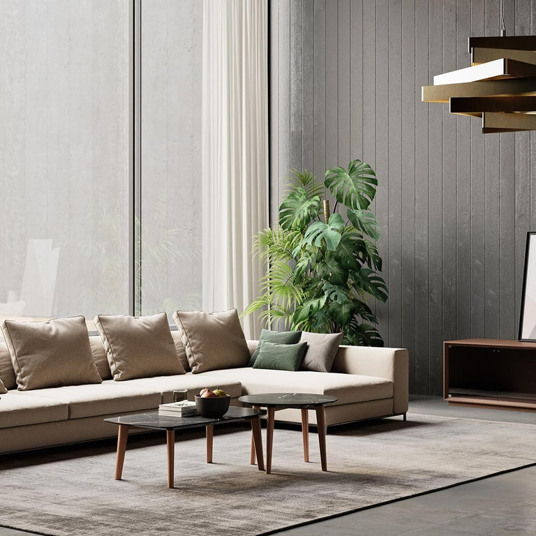This exclusive coffee table exudes elegance and rustic charm. Tobacco-colored solid beech is used to craft the tapered, slightly slanted legs, supporting the alluring round top (2cm thick) in prized Pierre Grise marble. This piece will infuse subtle
