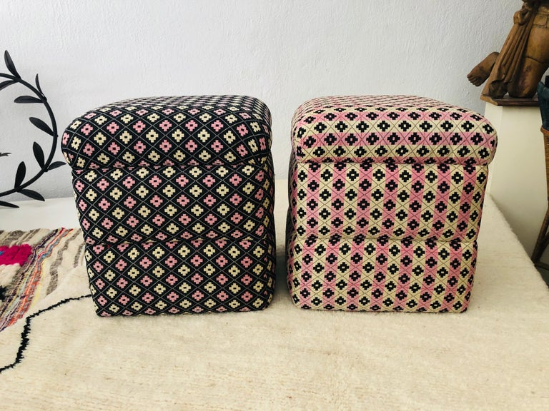 Art Deco cube ottomans. The compatible pair of ottomans are recently beautifully upholstered and are hand tufted. In addition to featuring beautiful print design in black, pink and beige, the cube shape creates a bold statement in the living