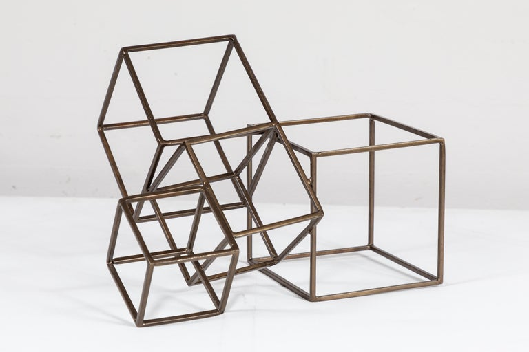 Table size welded brass boxes sculpture. Artist unknown.