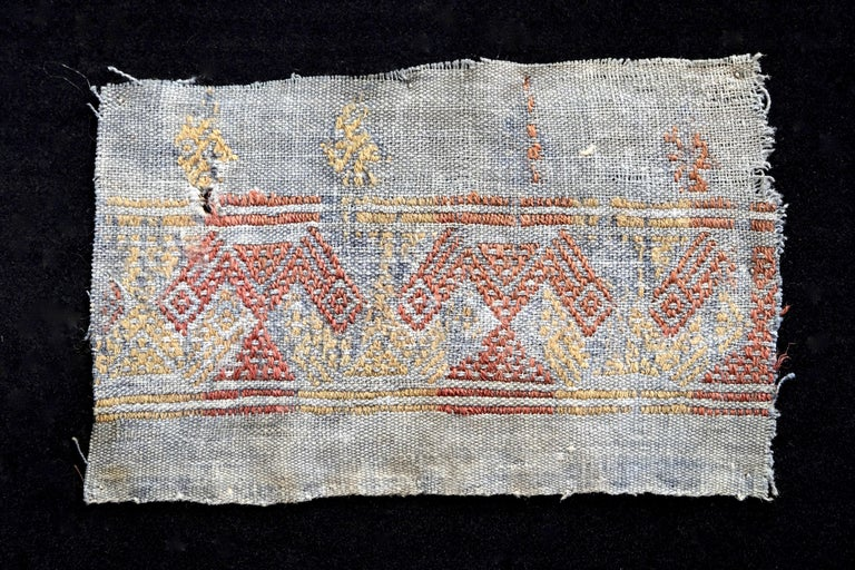 Blue pre-Columbian textile pattern with red and yellow abstract cubists designs. This piece is mounted on a black shadow box.  It is a wonder to behold antiquities such as a pre-Columbian textiles, an authenticpiece of art that has been preserved