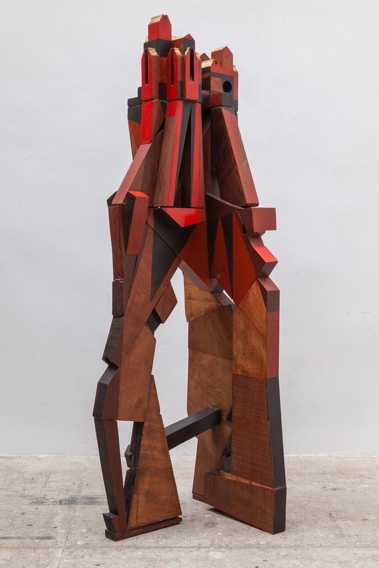 Large wooden sculpture by the Artist Jhan Paulussen, Belgium, 1960s. Signed JH. Cubist design in solid wood, reds, and browns which appears to be cityscape resting on a mountaintop. The top can be lifted off of the base into two parts.  Dimension: