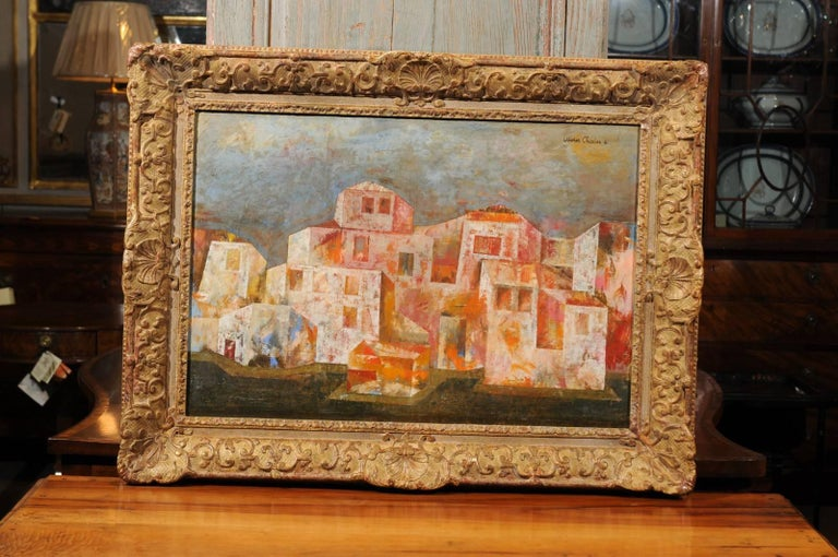 The Cubist style oil on canvas painting with architectural scene in orange, white and blue hues. The giltwood frame is from the 19th century.