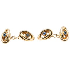 Cufflinks Antique French Gold Loops with Central Cabochon Sapphire, circa 1920