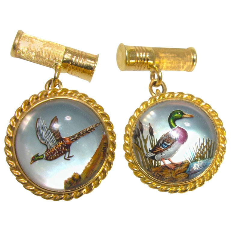 Cufflinks in Gold with a Fine Enamel Hunting and Shot Shell Motif, circa 1935 For Sale