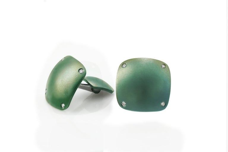 Refined modern yet classic cufflinks, handcrafted in titanium, oxidized green, in a slightly bombé shape. The back has same shape in smaller size.   They can be customized engraving two letters or a date, upon request. Please let us know your idea
