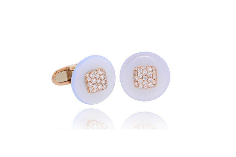 Handcrafted in 18 Kt rose gold for grams 8.70 The round natural light blue chalcedony is centering  a diamond pavé square detail and the T-bar is set with a line of 8 diamonds. Total colorless diamond best quality carat weight 1.00  We can custom